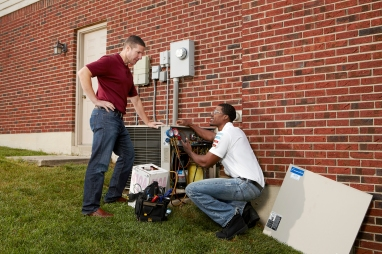 Service tech talking with homeowner 1_HR